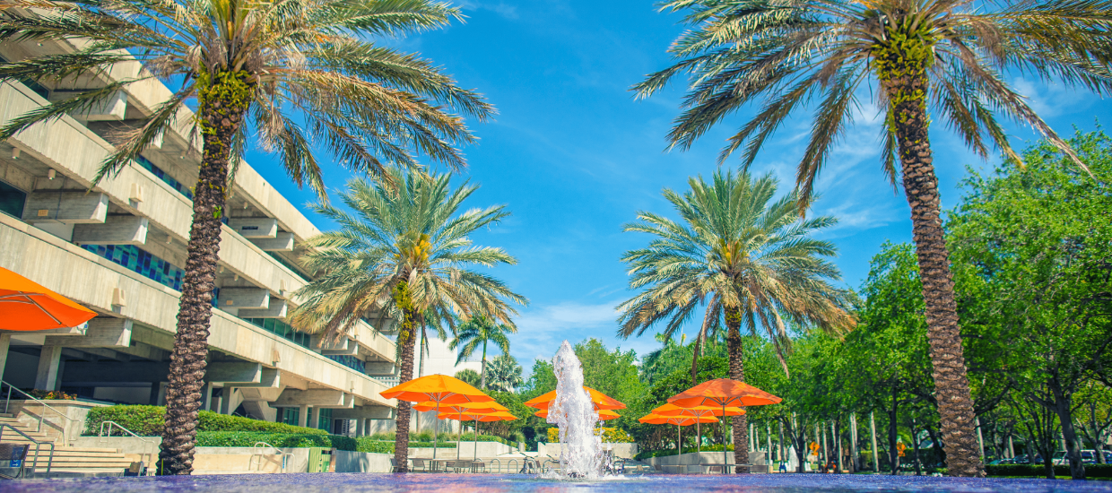 Cox fountain with palms and umbrellas